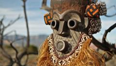 African Primitive Mask Scary Savage Landscape Tilt Up - stock footage