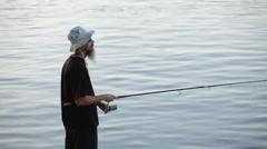 Fisherman casting Stock Footage