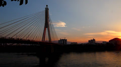 Mekong river, so called Lantsang river, in sunset , with cable stayed bridge Stock Footage