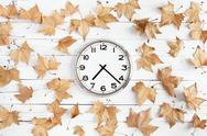 Stock Photo of clock with leaves