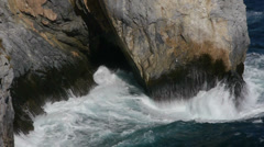 Waves against the rocks Stock Footage