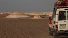 Jeep passes through the rocks, White Desert, Egypt Stock Footage