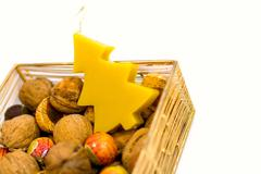 walnuts, sweets and handmade candle - stock photo