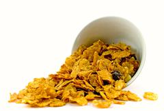 Cornflakes from bowl Stock Photos
