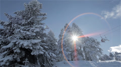 Snowy trees and ski lift Stock Footage