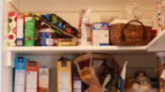 Out of focus pantry shot Stock Footage