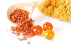 natural sponge, bath salt and oil balls - stock photo