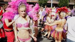 Young blonde carnival queen dances at Gay Pride Parade Stock Footage