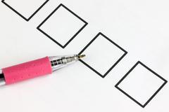 pick pen point to checkbox. - stock photo