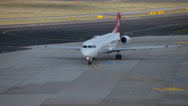 Stock Video Footage of helvetic airways  fokker 100 jet airplane hb-jve taxiing dusseldorf airport a