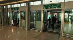 Passangers travelers boarding skytrain h-bahn hanging railway cabin dusseldor Stock Footage