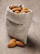 small sack bag full of almonds - stock photo