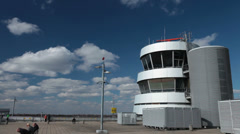 Jet airplane taking off by radar control tower at dusseldorf airport. Stock Footage