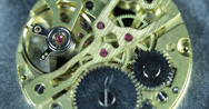 Stock Video Footage of Ultra HD 4K Mechanism Old Watch Close-up CloseUp Springs Wheels Stainless Steel