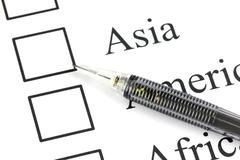 mechanical pencil point to checkbox in asia text. - stock photo