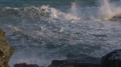 Waves with white foam against the rocks Stock Footage