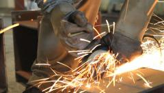 Industrial Worker cutting steel metal with grinder Stock Footage