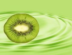 Slice of ripe kiwi taken closeup on green background. Stock Illustration