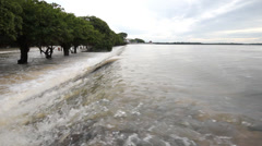 Flood, Water flow over road. Stock Footage