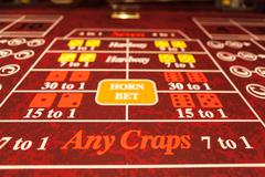 Craps table with red felt Stock Photos