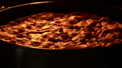 Zoom in on a nearly finished pie baking in an oven. Stock Footage