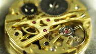 Stock Video Footage of Old Watch Clock Machine Golden Background Gears Elements Chain System Cogs Twist