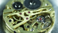 Stock Video Footage of Old Watch Clock Component Mechanism Golden Gears Elements Chain System Cogs Ruby