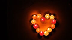 Candlestick encrusted heart shape. Stock Footage