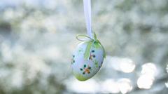 Easter egg on a flowering tree branch Stock Footage