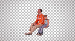 man & child on spectator seats - stock footage
