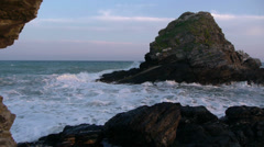 Waves in the rock of the middle island Stock Footage