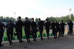 policemen standing guard over order in the stadium - stock photo
