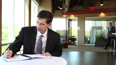 Asian Businessman writing report Stock Footage