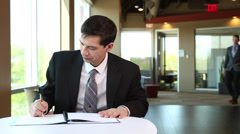 Asian Businessman writing notes Stock Footage