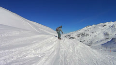 Snowboarding off piste in Val Thorens Stock Footage