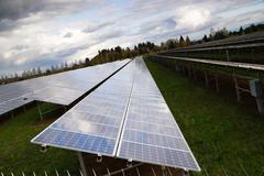 Large bank amorphous solar panels green renewable energy sun power Stock Photos