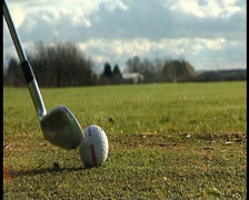 Golf ball line up then hit Stock Footage