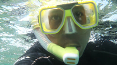 Close up of a Snorkeler near the surface at the Great Barrier Reef Stock Footage