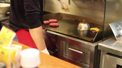 Burger bar onions on top Stock Footage
