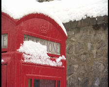 Telephone box in snow Stock Footage