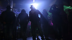 Male dancers dancing in rave party - stock footage