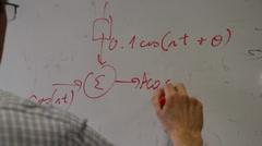 Writing math formula on a whiteboard Stock Footage