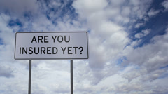 Sign Insured Yet Clouds Timelapse Stock Footage