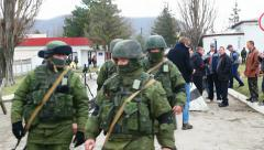 Russian soldiers marching in Perevalne, Crimea, Ukraine Stock Footage
