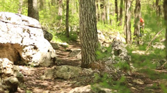 Riding mountain bike thru the woods Stock Footage