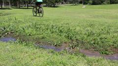Mountain bike riding thru creek Stock Footage