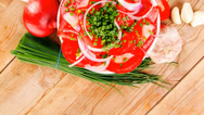 Stock Video Footage of tomato salad in white bowl with bundle of chives