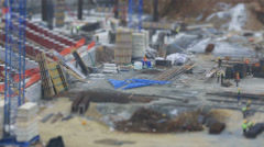 Tilt shift construction zone with heavy equipment and workers 2 Stock Footage