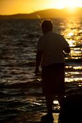 Fisherman at dusk Stock Photos