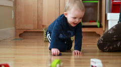 A mom and boy playing with toy cars Stock Footage